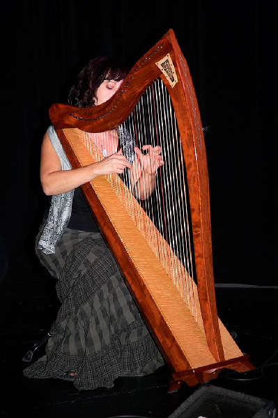 Kathy Pepers playing a harp